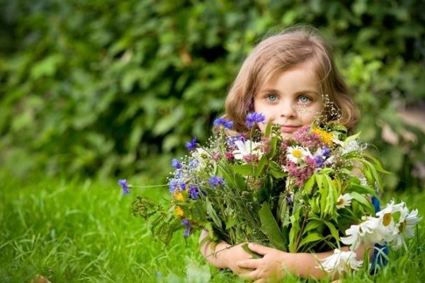 Girl holding flower bouquet 2